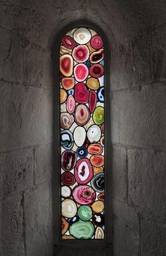 This piece of stained glass in the Grossmunster Church is made from the semi-precious stone agate.  Amazing isn't it?  We've got another collection of stained glass at http://theownerbuildernetwork.com.au/stained-glass-a-many-coloured-splendour/