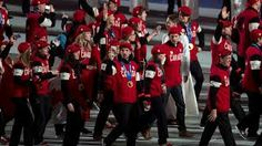 Members of the Canadian team enter the stadium for the closing ceremonies for the Sochi Winter Olympics in Sochi, Russia, Sunday, Feb. 23, 2014.
