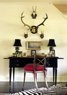 I indeed own horns, and my desk is on a wall like that. hmmm. chic or no?