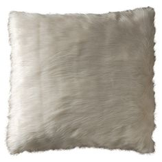 Add a touch of texture to your sofa or loveseat with this chic faux fur pillow, showcasing a crisp white hue for stylish appeal.  Pr...