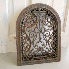 Love this old heating vent grate. Maybe used as a window cover or mirror.