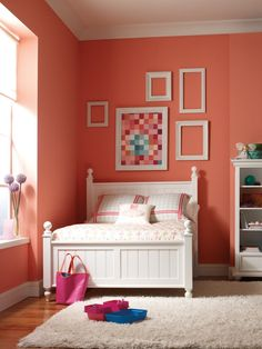 Coral and White. This bold bedroom implements a lot of coral on the walls, but anchors the bright color with crisp, white accessories. White can be a great go-to color to break up bright, colorful walls.