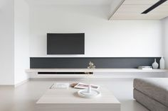 Nice shelving detail built into this minimalist living room