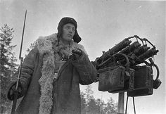 Anti-aircraft machine gun.  Soviet sentry near a quad Maxim anti-aircraft machine gun.
