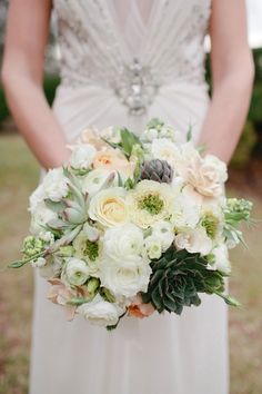 Not sure what I love more - the gown or this bouquet! #succulents #weddingbouquets By TresBellaFlorist.com, photo by Kellie Kano - http://ruffledblog.com/galleries/secret-garden-inspiration-shoot/?pid=45216