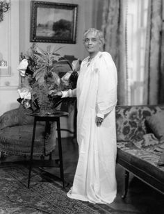 Suniti, the Maharani of Cooch Behar - in mourning, 1929 when she was about 65 years old. Her son Jit was devastatingly handsome, Jit's daughter, her granddaughter, was the exquisitely beautiful Gayatri Devi of Jaipur. But all those good looks don't matter when your husband and sons die young. Suniti's sense of style was highly fashionable early on, and even here her utter calm and unique way of wearing an absolutely plain white saree over a long-sleeved blouse, are striking and timeless.