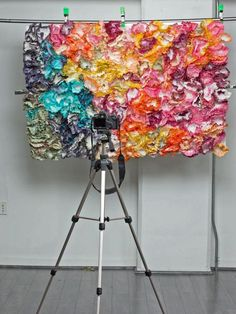 Create a colorful DIY photo booth using dyed coffee filters.
