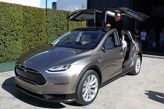 Tesla Model X.  Completely electric, all wheel drive, seating for seven, and 0 - 60 mph in 4.4 seconds.