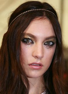Smudgy glitter glam rock makeup -- I like this with a dark lip and more glitter.