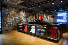 Highlighted with the Gangnam space is a stunning centerpiece that pays homage to Nike's latest innovations with various running, basketball, and football product while the brand's commitment to sustainability is illustrated with wood flooring recycled from Korea University's basketball court.