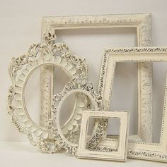 vintage cream antiqued frames, going to redo my guest bedroom in shabby chic with an iron bed, love this......