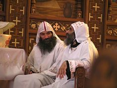 riests chatting during the Coptic Liturgy in the Cathedral of Deir Anba Bishoy.
