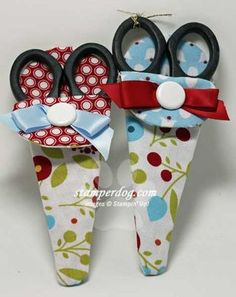 I have been wanting to make some of these for a while now - Cute scissor holders made with some Stampin' Up! Summer Smooch fabric. The fabric was cut using a dresden plate die and made by Ann Clemmer.