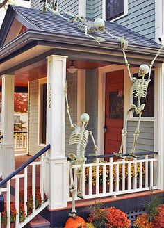 Front Porch Halloween Decorating Ideas • DIY projects, Tutorials and Ideas! Including, from 'BHG', this rooftop skeleton caper idea.