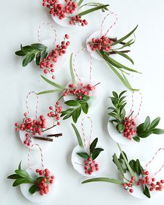 These look impressive but are super easy to make! You just need some tea lights, greenery, a pop of something red, and string.