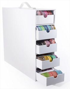 """Totally Tiffany - Stash and Store - 5 Drawer Supply Case at Scrapbook.com is the perfect place to store all your bulky craft supplies all in one place and will fit in most standard cube storage systems. To maximize your cube style furniture, three Stash and Store cases will fill one cube. Each drawer has a removable divider insert and can hold up to 25 rolls of washi tape. Case measures 4.25"""" wide x 13"""" tall x 14"""" deep."""