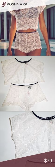 Victoria's Secret lace crochet top and shorts set 205- New with tags Victoria's Secret lace / crochet top and shorts both are size medium . The set is white with blue trim . No flaws . The top is cropped with an open back. Pink picture to show the back. The shorts are high waisted with a zipper and hook closure unlined . Super cute swim cover set Victoria's Secret Swim Coverups