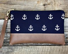 Ships out 2 to 4 days after purchase. This Nautical Navy Blue Clutch with White Anchors has brown faux leather on the bottom and for the strap. This is the perfect size to carry your items in: your cell phone, keys, make-up, money, Navy Blue Clutch, Pochette Diy, Pouch Pattern, Diy Handbag, Striped Canvas, Bag Patterns To Sew, Sewing Patterns, Bleu Marine, Clutch Purse