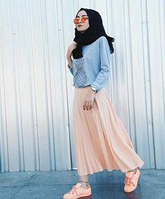 Peach maxi skirt with peach shoes & glares & wearing pineapple sweater with black hijab