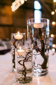 Chic Kentucky Barn Wedding Unique centerpiece idea - glass floating candles with branches Kate McStay Photography You are in the right place about diy wedding table Here we offer you th Barn Wedding Centerpieces, Floating Candle Centerpieces, Elegant Centerpieces, Diy Wedding Decorations, Wedding Ideas, Centerpiece Ideas, Centerpiece Flowers, Floating Candles Wedding, Decor Wedding