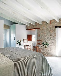 Mediterranean villa - designed by Mestre Paco. Beautiful bedroom. Love the wooden beams and stone walls