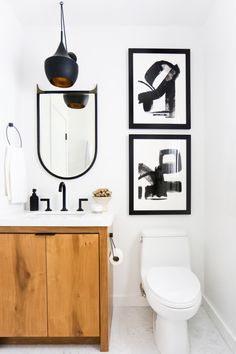 The upstairs bathroom has much the same feel of the guest bathroom downstairs (including the same glam Brizo faucets) but has the added benefit of these amazing prints by my friend Jaime Derringer from Minted.