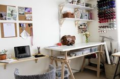 love this craft sewing room - pin board, cone thread holder, shelving