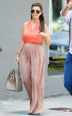 Kourtney Kardashian. my faveee!!! Tht hair and outfit tho!