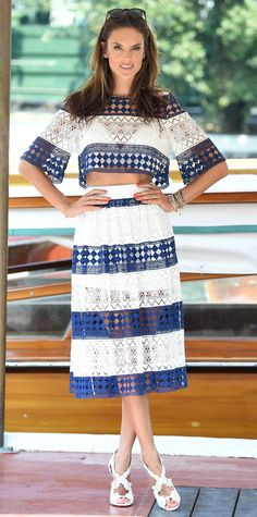 Alessandra Ambrosio's Venice Film Festival run was off to a stylish start. On the first day, she turned heads in sweet blue-and-white paneled lace separates that scandalously revealed glimpses of skin. She styled her look with an arm party stack and white sandals.