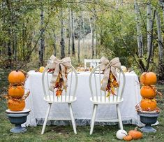 Harvest Wedding table idea from @fawn_parties is perfect for the fall bride, or really anyone celebrating the beauty of the season. Click to shop this look and see her easy DIYs. #fallweddingideas #weddinginspo #outdoorwedding #falltableideas #harvesttableideas #thanksgivingtableideas #pumpkins #pumpkindecor #orientaltrading #fun365