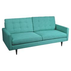 Craft a midcentury-inspired room around this retro-chic sofa, featuring tufted details and teal cotton-linen upholstery.   Product:...