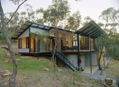 bushfire resistant external materials Bush home just 15 minutes from Adelaide with roofing and wall cladding made from ZINCALUME® steel. House On Stilts, House Roof, Facade House, Container Home Designs, Houses On Slopes, Wall Cladding, Cladding Ideas, Steel Cladding, Shed Homes