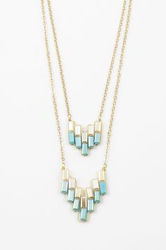 Handmade Ethereal Iridescent Ivory and Aspen Blue Crystals woven in Golden layers. ==