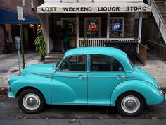 Morris Minor 1000- love this photo not just for the car, but for the store in the background! :)