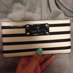 Kate spade wallet  Black and white wallet lightly used. No marks or major stains/scuffs. Great condition! kate spade Bags Wallets
