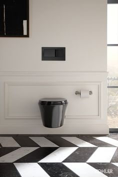 Kohler: Veil wall-hung toilet . http://ideas.kohler.com/mood-board/chic-hollywood-bathroom