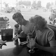 A teenage couple enjoying milkshakes at a diner, San Diego, California, USA, December Photo by Martha Holmes. Teenage Couples, Young Couples, Cute Couples, Vintage Romance, Vintage Love, Couples Vintage, Photos Amoureux, Old Fashioned Love, Old Love