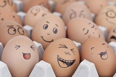 Tray of eggs with faces,close-up - Royalty Free Images, Photos and Stock Photography :: Inmagine