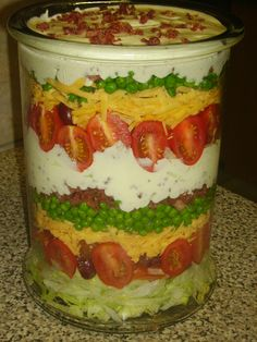 Stack salad. Any green salad, tomatoes,  olive, grated cheddar cheese,frozen green baby peas, small pieces crispy fried bacon,  top with mayonnaise of your choice. Do one or as many layers as you like, decorate with some fried bacon. let it rest in fridge for at least 8 hours and enjoy!