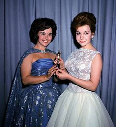 Actress Annette Funicello, right, and former child film star Shirley Temple, left, are seen holding a miniature Oscar statuette at the annual Academy Awards presentations, in Los Angeles, Calif., in April 1961. (AP Photo/Brich) Photo: Brich