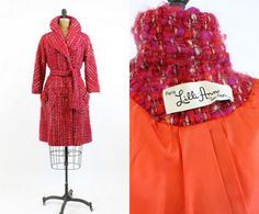 Chic and completely coveted early 1960s Lilli Ann coat! Done in a super chunky woven sweater like wool. The colors are amazing! Hot pink, orange, and gray knitted together. Front buttons, wide collar and lapels and slanted pockets. Matching belt to cinch the waist. 3/4 length sleeves.