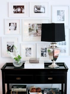 White frames gallery wall - with black and white photos. I like the black accessories too