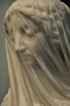 The illusion of transparent cloth from purple marble (The Veiled Virgin, by Giovanni Strazza, 1856) exquisite