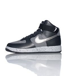 23375d38432c47 NIKE Men s high top sneaker Air Force One style body Lace up closure  Signature NIKE swoosh on sides of shoe Padded tongue with lunar force 1 logo