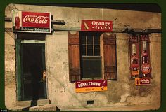 A store in Natchez, Mississippi, advertises Coca-Cola, Orange-Crush, Royal Crown, Double Cola, and Dr Pepper
