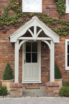 A classy Belbroughton door is perfect for this home. Painting the door and porch in French Grey makes it clear to guests that it's the front door