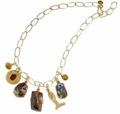 Elemental charm necklace in 22k gold with Yowah opal charms ranging in weight from 10.8 cts. to 18.3 cts., and citrine, rubellite, and fish-motif charms, $19,685 as shown; Stephanie Albertson