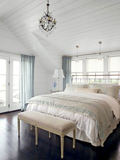 Light and Bright..Light and airy colors create serenity in this bedroom. Piles of fluffy bedding and pillows support the vibe. Ebony floors ground the room. What I love: The emphasis on the architecture. Planking adds interest to the soaring ceiling. #decorate #bedroom