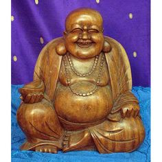 Wooden Chinese Laughing Buddha. Not to be confused with the spiritual deity, the Laughing Buddha is in fact a nickname for a legendary character, the Budai who is said to have lived in China during the Later Liang Dynasty (907–923 CE) The Budai was considered to be a good and loving character. A popular belief is that rubbing this fellow's belly will bring good luck! He is holding a gold ingot for prosperity.
