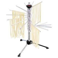 """KitchenAid Pasta Drying Rack - Holds more than 4 pounds of fresh pasta and has 10 feet of drying space. The rack frees counter space and helps promote fast, even drying. Made of 16 sturdy, clear polycarbonate rods. Also includes a multi-purpose """"wand"""" that helps transfer pasta from the pot to the drying rack and helps cut the pasta. Unit folds flat for easy storage. 1 1/2 lbs. 19""""H x 17""""W x 17""""D. http://www.chefscatalog.com/product/24145-kitchenaid-pasta-drying-rack.aspx"""